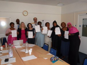 Photo of refugee leaders receiving their leadership training certificates